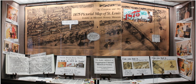 "The September 2015 display case at Oak Bend Library features the 1875 pictorial maps of St Louis and the graphics in the exhibit, ""Wa Walk in 1875 St Louis"" at the Missouri HIstory Museum."