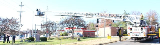 Mehlville fire department restores flag to pole in Memorial Park, Sunday, November 22, 2015.