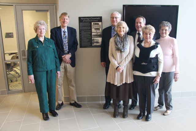 SCHS board members in front ot plaque donated to the Lindbergh Schools.