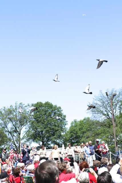 Doves of peace circle over crowd at annual SCHS Memorial Day ceremony. Photo by Bill Brinkhorst